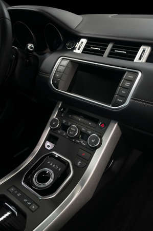 Modern luxury car control panel. Interior detail. Vertical photo. Stock fotó