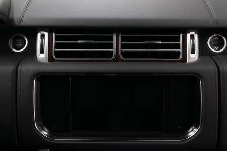 Modern car dashboard. Multimedia screen close-up. Interior detail.