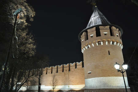 Tower and part of the wall of the Tula Kremlin. Night. Winter.