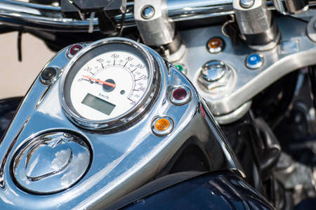 close-up of the motorcycle speedometer. speedometer on the motorcycle. motorcycle classic. chrome and classic numbers on the speedometer dial.