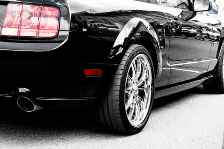 side view of the American car - muscle car. chrome-plated large wheels, black body color. contrast photo Stok Fotoğraf
