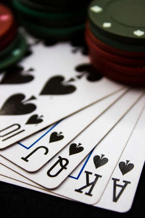 Cards laying around with poker chips on top. photo