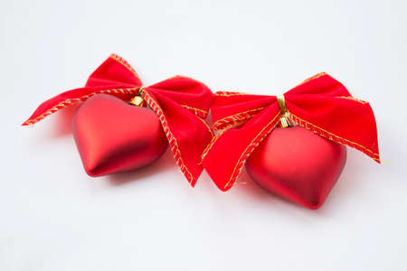 Heart shaped decoration with ribbons around it. Stock Photo