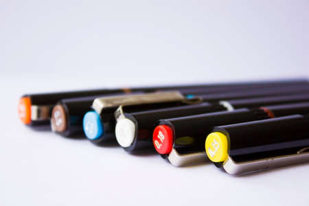 Technical pens on a white background.