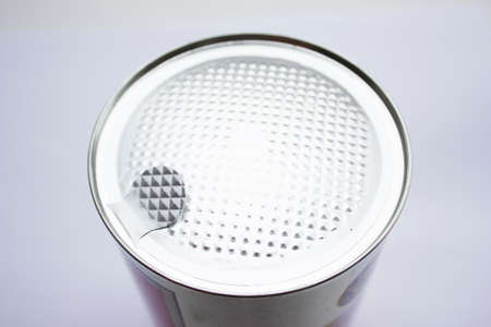 tincan: Silver colored can with sealed top on a white background.