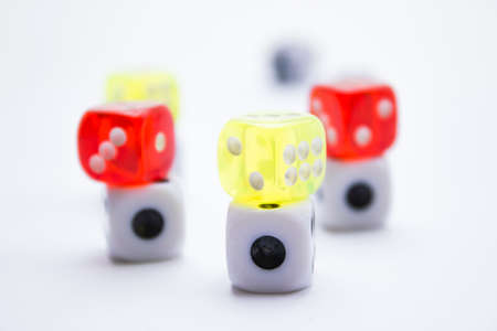 Composition from different colored dices on a white background. photo