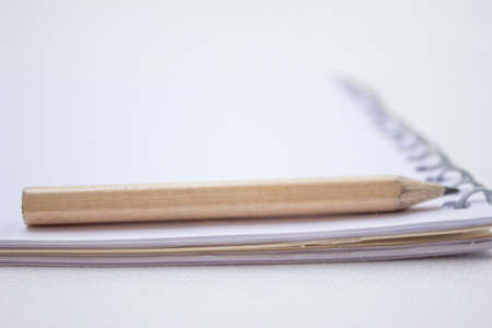 Pencil in a composition with a blank book photo