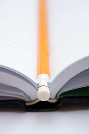 Pencil in a composition with a book with hardcovers. photo