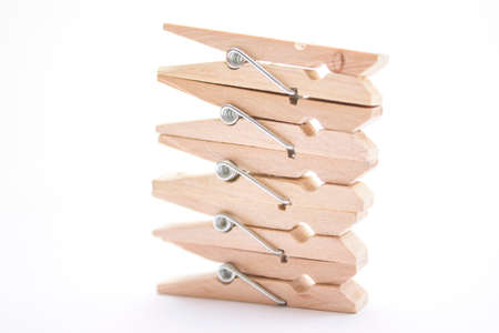 Composition of several wooden pegs on a white background. photo