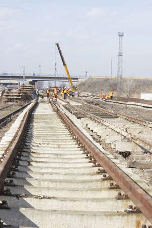 Railroad metal train tracks shot at perspective view.