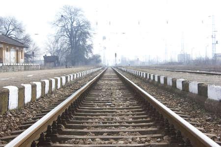 Railroad metal train tracks shot at perspective view. photo