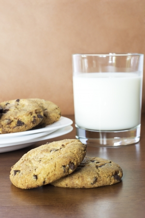 Oatmeal cookies with chocolate and a glass of milk photo