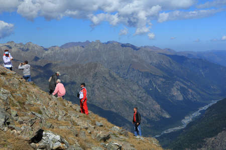 People rising on a slope on mountain top