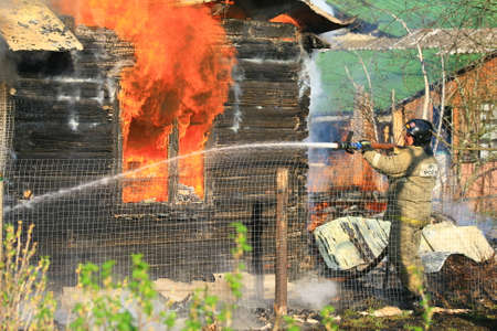 burning house: The photo in which I managed to imprint work of the firefighter at suppression of the burning house.