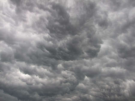 Dark, dense and magnificent, gray storm clouds photo