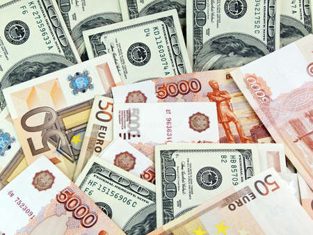 roubles: Heap from dollars of the Russian roubles and euro Stock Photo