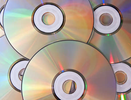 Heap of disks with beautiful iridescent refraction of light photo