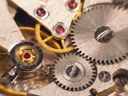 Macro photo of the mechanism of a watch soft focus photo