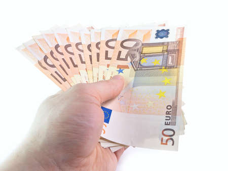 euro banknote: The isolated denominations in 50 euros in a hand Stock Photo