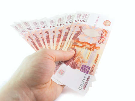roubles: The isolated five-thousandth of Russian rubles denominations in a hand Stock Photo