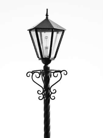 The isolated black metal streetlight whith a bulb photo