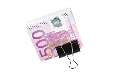 Bundle of 500 Euro bank notes fasten with paper clip isolated on white background photo