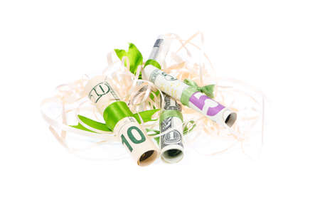 Tied with a green ribbon dollars in tinsel on a white background photo