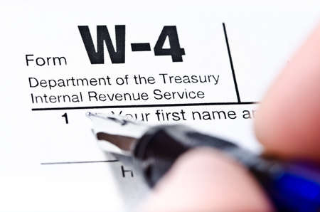 filling out: The process of filling out the W-4 form, shallow depth of field