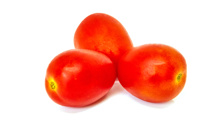 three Cherry tomatoes isolated on white background