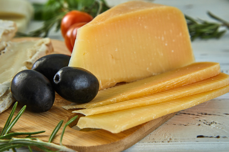 Different cheeses on table. Fresh dairy products. Cheese selection on a wood table, Gourmet Stock fotó