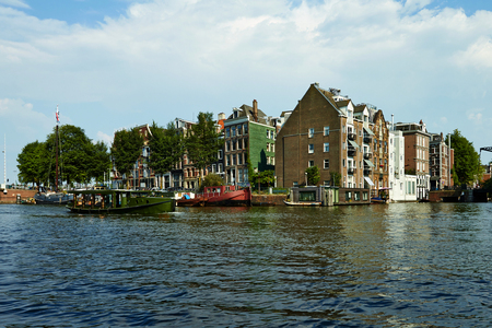 Canals and boats of Amsterdam. Holland July 2018