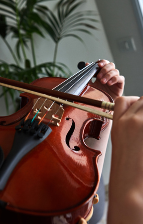 Violin classic musical instrument. Classical player hands. Details of violin playing.