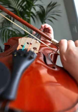 Violin classic musical instrument. Classical player hands. Details of violin playing. 版權商用圖片