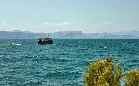 View of the Sea of Galilee with a pleasure boat from the east side on a summer sunny day 版權商用圖片