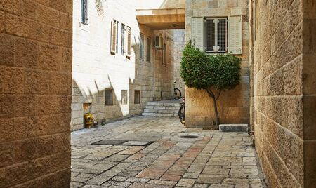 Ancient Alley in Jewish Quarter, Jerusalem. Israel. Photo in old color image style. Stock Photo