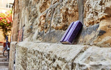 Jerusalem, Israel - October 21, 2019: Prayer Book Time of Will - Hebrew inscription standing on the stones of the old city of Jerusalem.