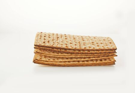 Pesah celebration concept - jewish Passover holiday. Stacked matzoh isolated on a white background.