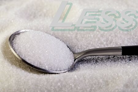 Less text, sugar slide on a spoon, suggesting a diet and health concept.