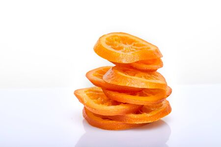 Slices Dried oranges or tangerines isolated on a white background. Vegetarianism and healthy eating. Stack