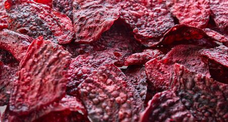 Diet healthy eating concept. Healthy purple baked beets or dried beets with sea salt. Background texture. Organic natural food.