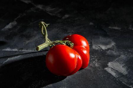 Ugly fruit or vegetable. Severely malformed mutant tomato. Food shops mostly prefer the best quality fruit and vegetables. Ugly fruit is not in high demand.