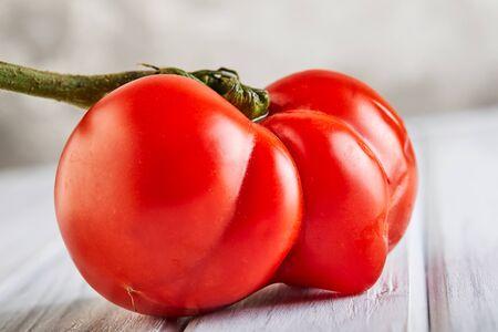 Ugly fruit or vegetable. Severely malformed mutant tomato. Food shops mostly prefer the best quality fruit and vegetables. Ugly fruit is not in high demand. Banco de Imagens