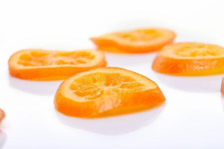 Slices Dried oranges or tangerines isolated on a white background. Vegetarianism and healthy eating. Фото со стока