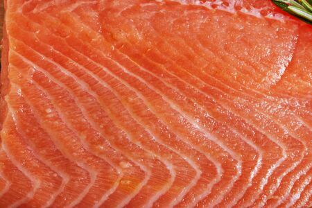 Raw salmon filet, background texture. Close up.