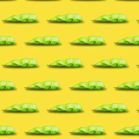 Edamame or soybeans pod pattern isolated on yellow background. Stock fotó