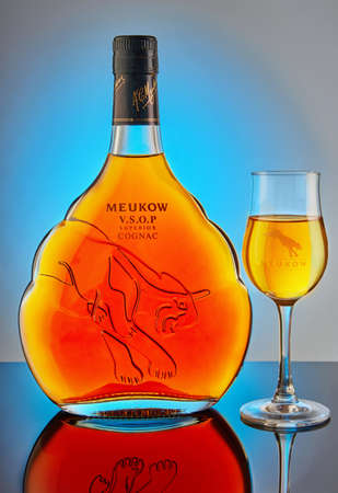 Tel Aviv, Israel - January 2, 2021: Meukow VSOP Superior cognac in bottle and glass.