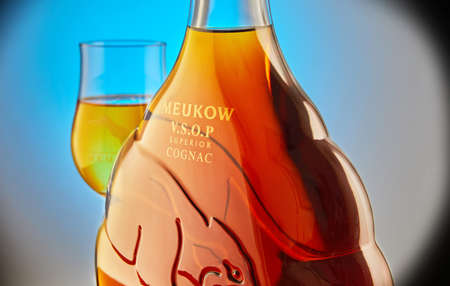 Tel Aviv, Israel - January 2, 2021: Meukow VSOP Superior cognac in bottle and glass. Close up