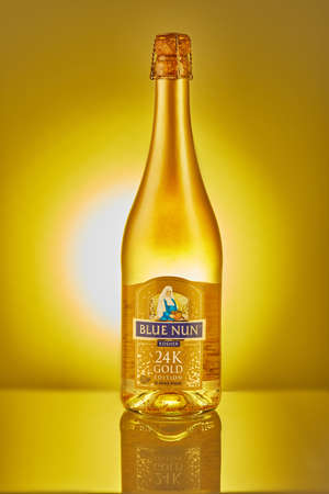 Rishon Lezion, Israel - January 25, 2021: Bottle of champagne 24 K gold edition, with gold inside.
