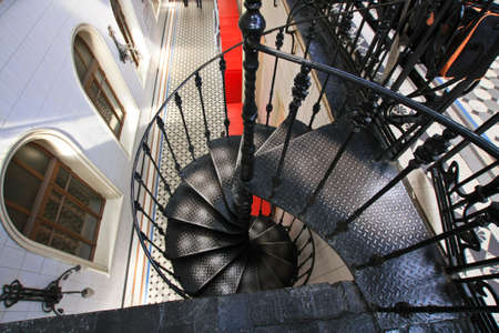 spiral staircase: Old metal spiral staircase with iron railing