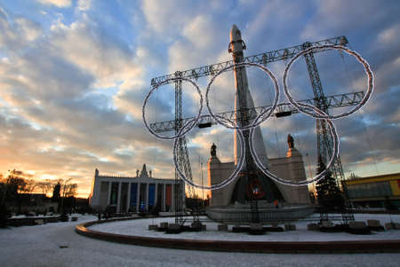 olympic games: The emblem of the Olympic games with rocket at sunset Editorial